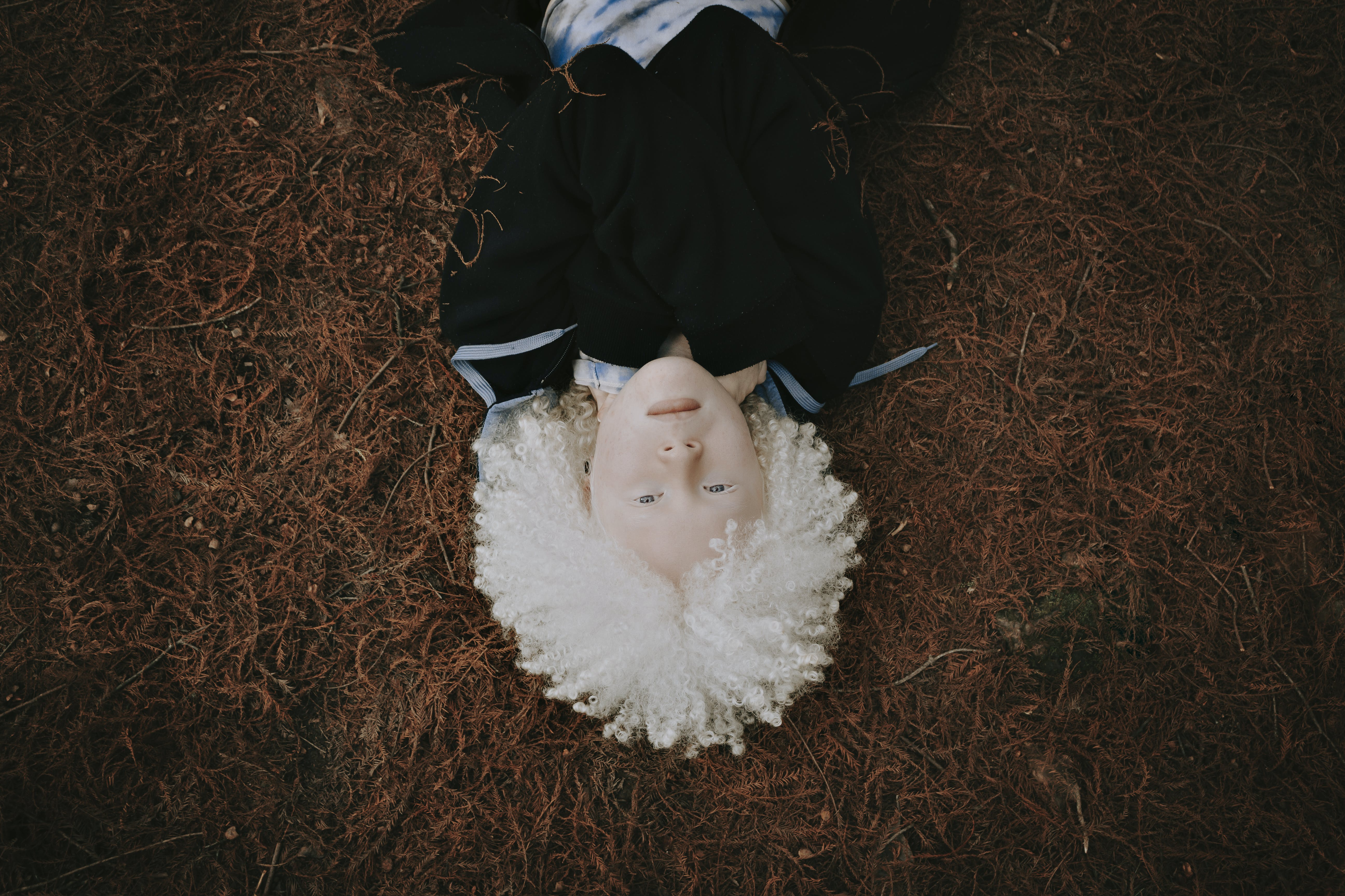 Person Lying on Grass Field