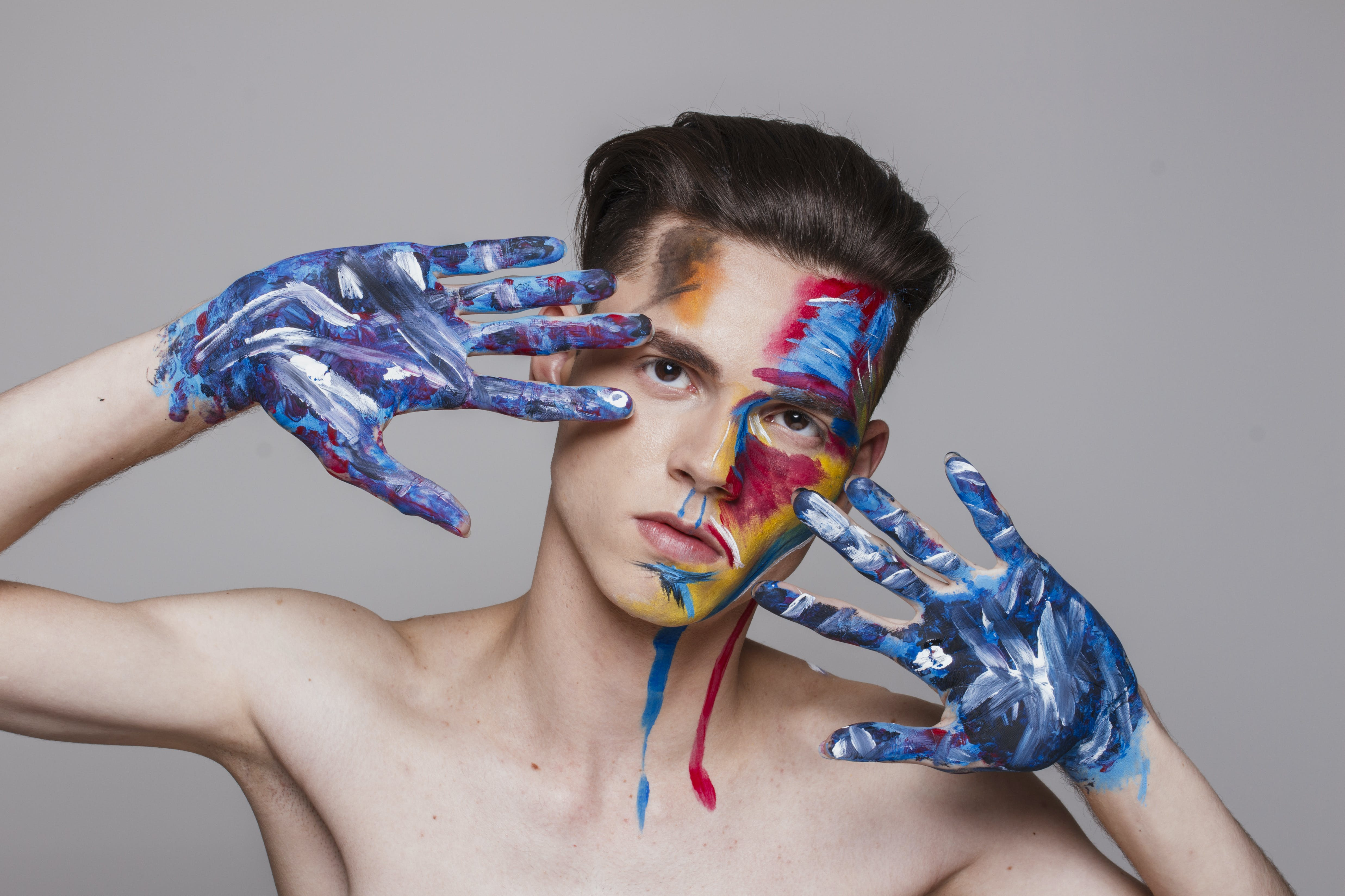 Man With Paint on Face and Hands