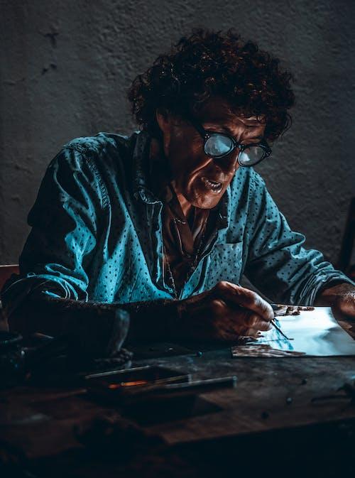 Free stock photo of man, man drawing, man in blue tsirts
