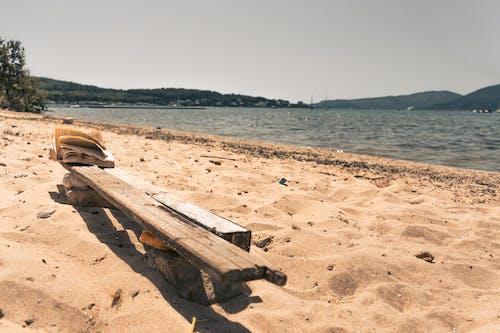 Free stock photo of beach, beach ner the sea, book on the cahir