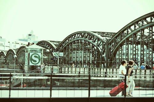 People Walking Near Steel Bridge