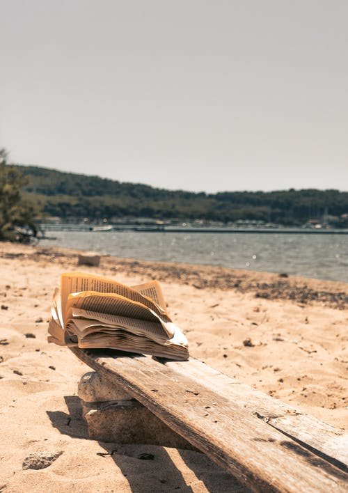 Free stock photo of book, book on chair, book on the beach