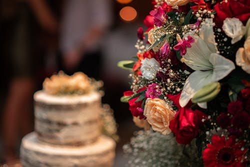 Bouquet of flowers and cake