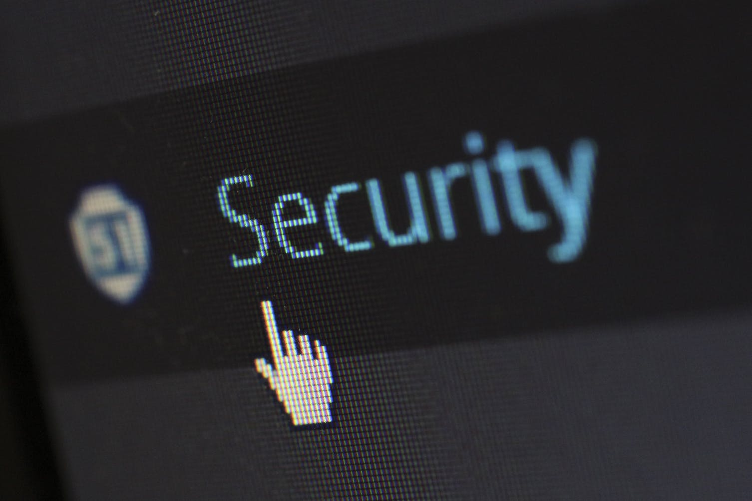 A picture of a computer screen where a mouse cursor hovers over the word security.