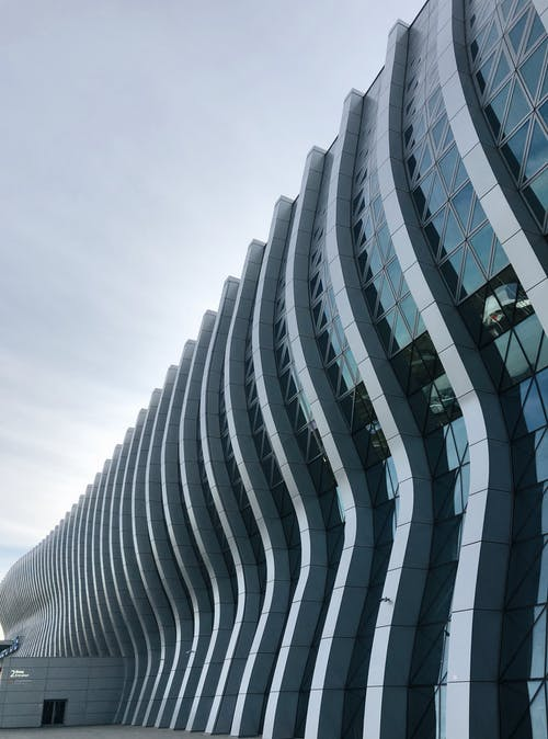 Low angle geometric facade of modern airport building with glass and concrete walls located in Simferopol