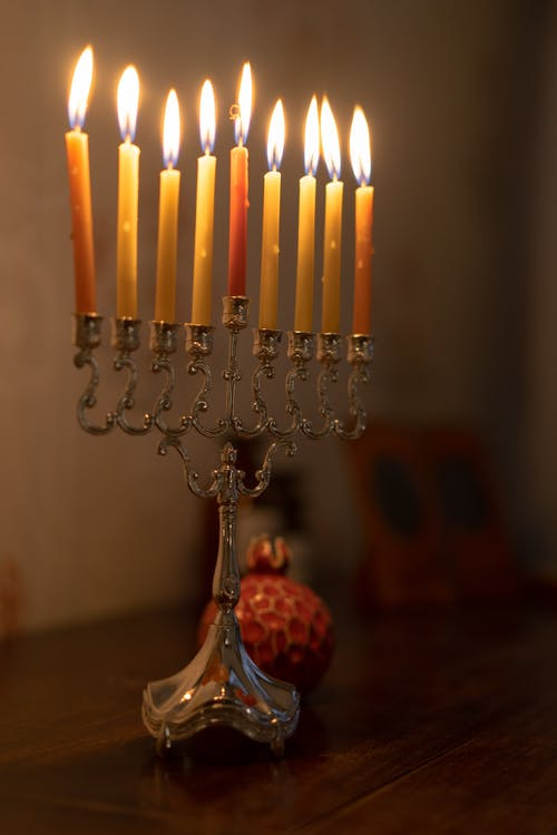 Lighted Candles On A Candelabrum