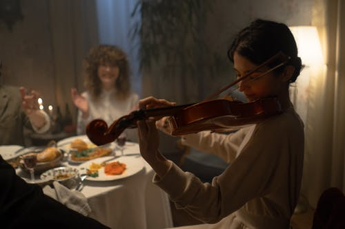Woman Playing Violin For Entertainment