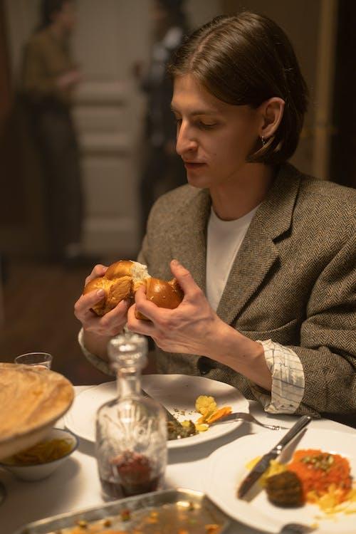 Man Holding A Challah Bread