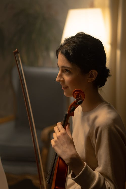 Portrait Of A Woman Playing Violin