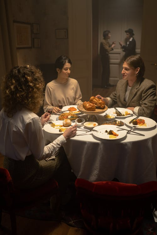 People Having Dinner And Celebrating Hanukkah