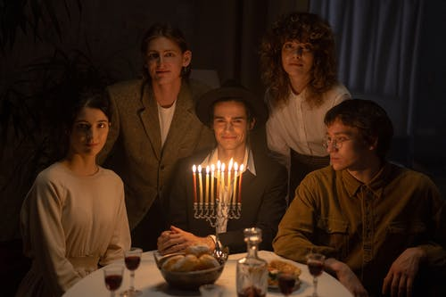 Family Gathering Celebrating Hanukkah