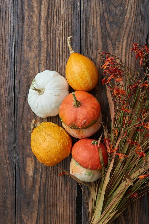 Pumpkins on Brown Wooden Table