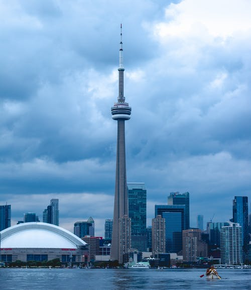 CN Tower Under White Clouds