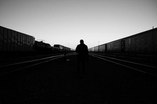 Silhouette of Man Walking on the Street