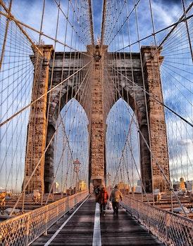 Two Person Walking on Bridge during Daytime