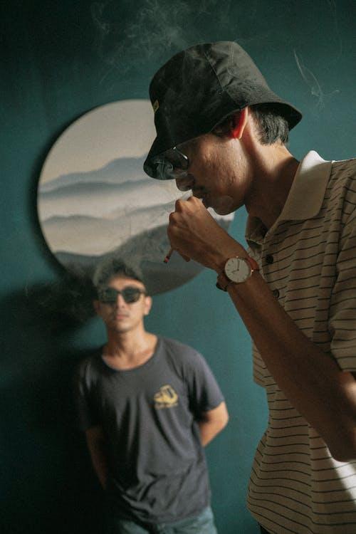 Man in Black Crew Neck Shirt Smoking Cigarette