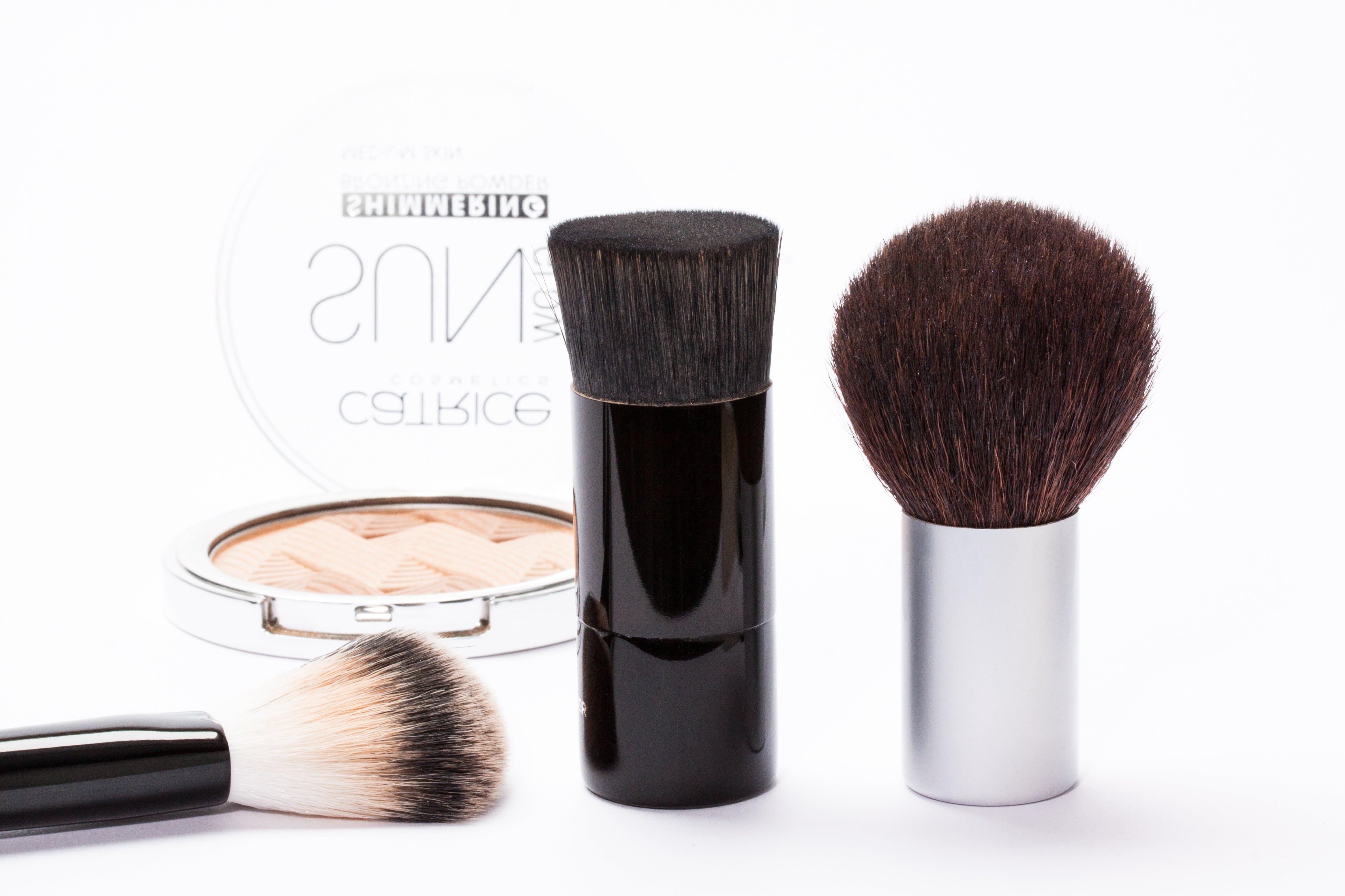 Black Make Up Brush Near Silver Make Up Palette