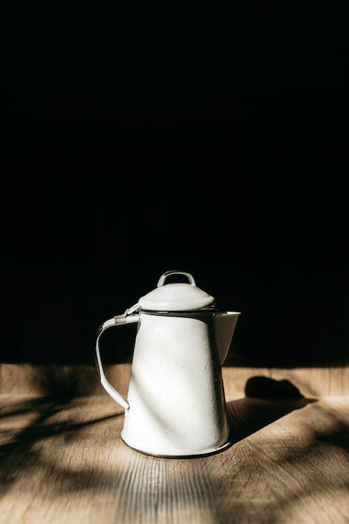 Vintage kettle against black background