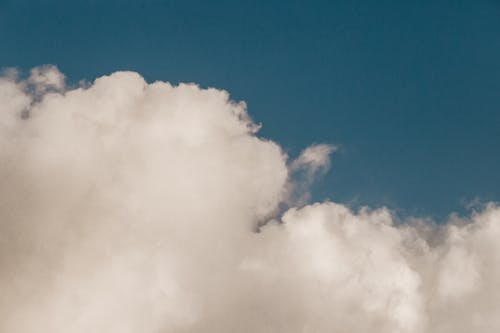 Scenic view of white big cloud with wavy edges in blue sky in daylight