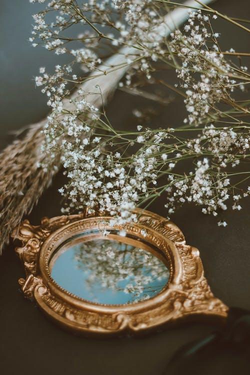 Gold Round Mirror Frame on Black Table