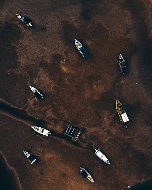 Fishing motorboats floating in pollute sea water