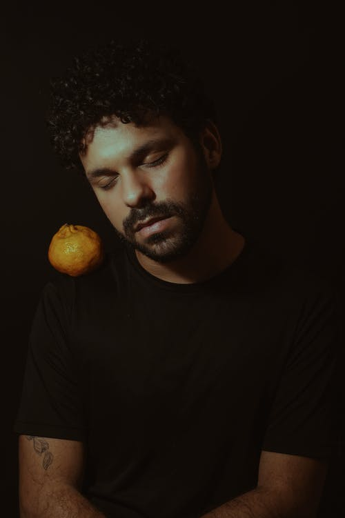 Ethnic male in studio with fruit