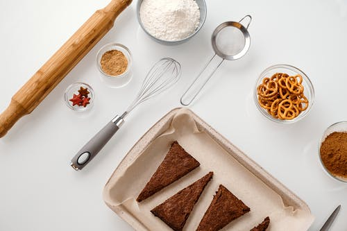 Top View of Baking Tools and Cookies on a Tray