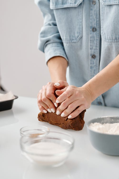 Photo Of Person Kneading Chocolate Dough