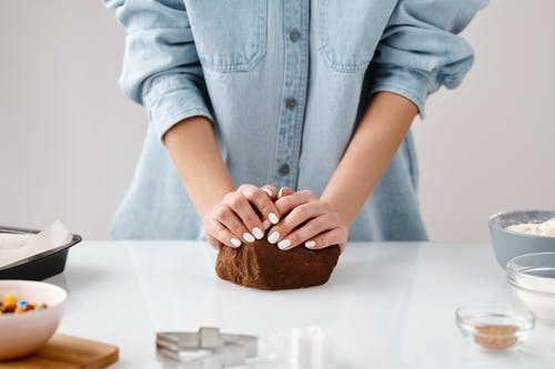 Person Kneading a Chocolate Dough by Hands