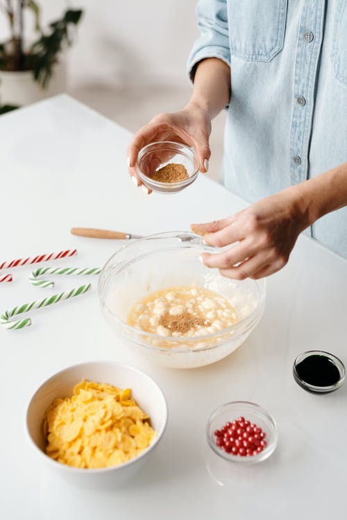 Person Mixing Baking Ingredients in a Bowl