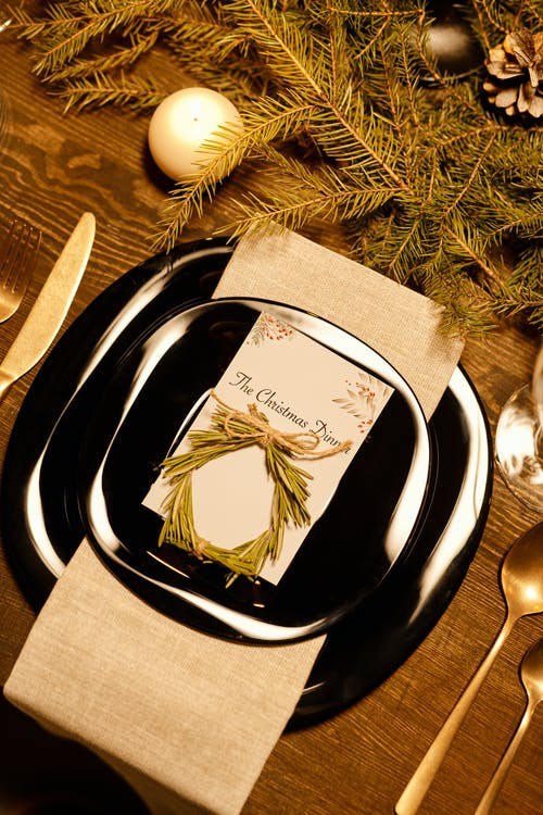 Top View of Christmas Dinner Card on a Plate