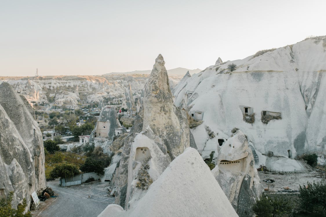 Amazing view of famous Cappadocia highlands with white rocky formations beneath clear blue sky