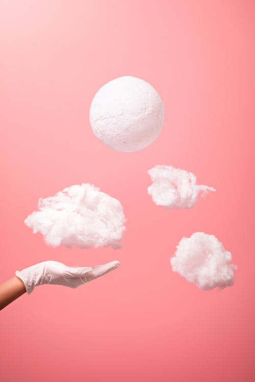 Person Holding White Cotton Candy