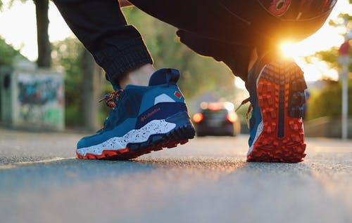 Person in Blue and Red Nike Sneakers