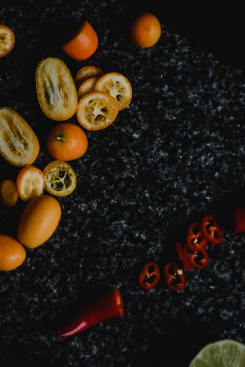 Sliced Kumquat on a Black and Gray Marble Surface