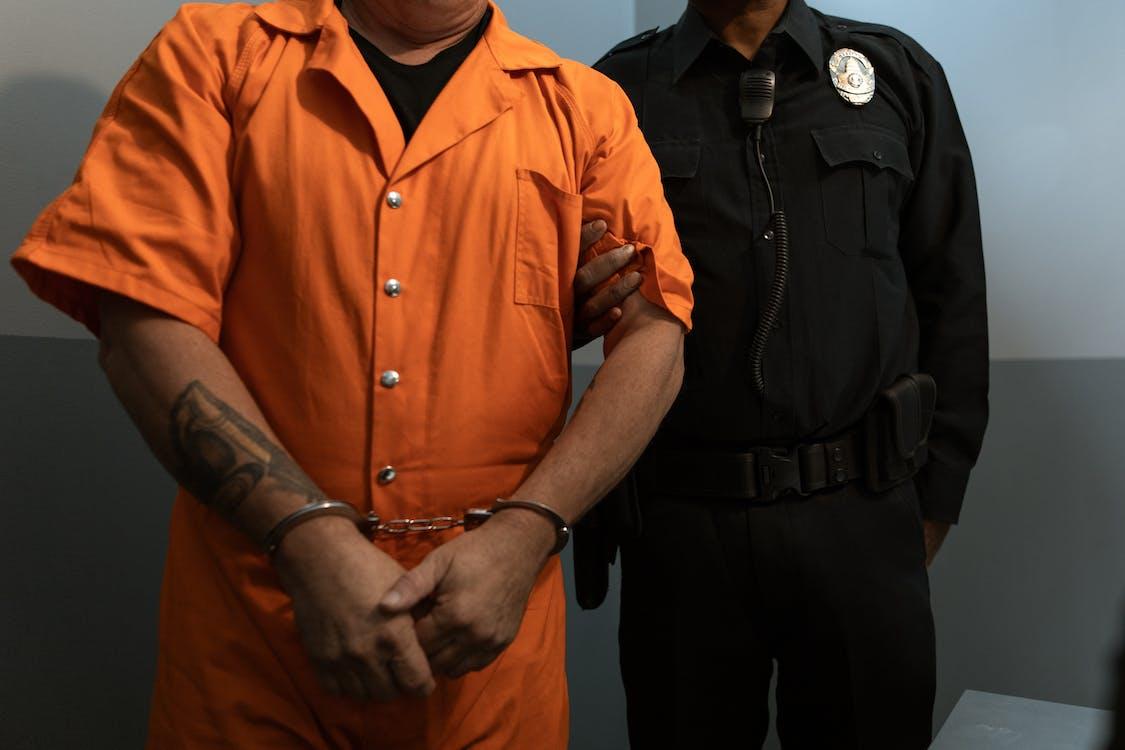 Man in Orange Button Up Shirt
