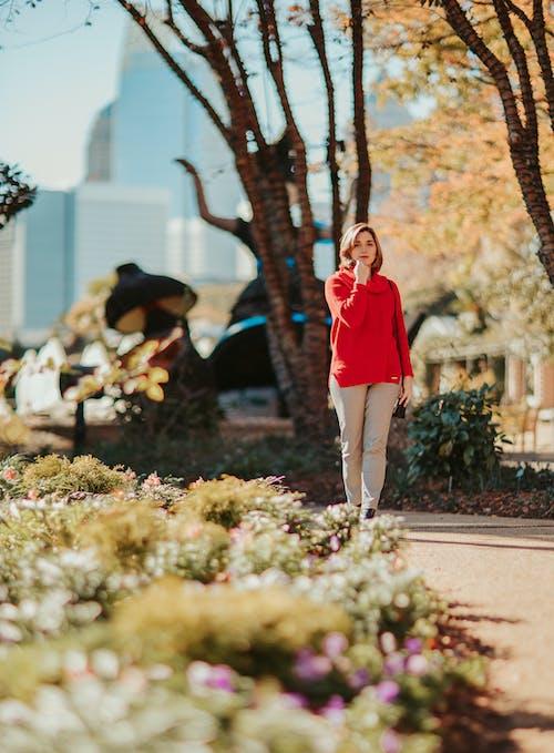 Stylish woman walking in park