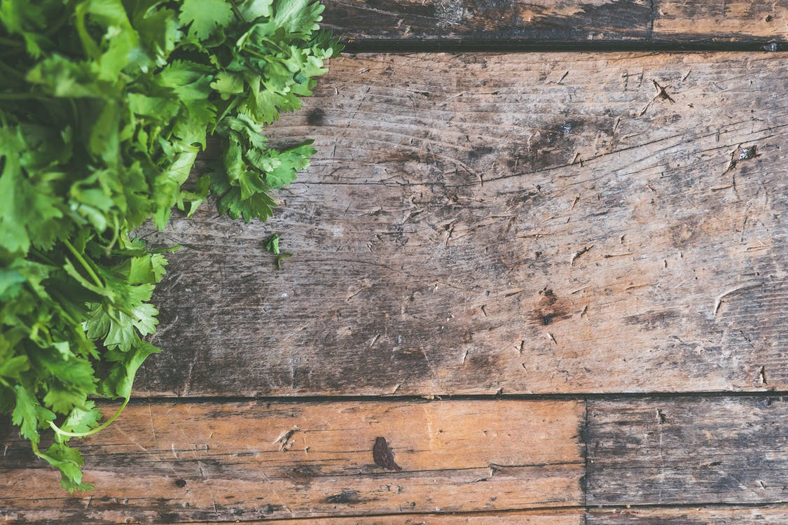 Parsley Leaves on Brown Wooden Surface