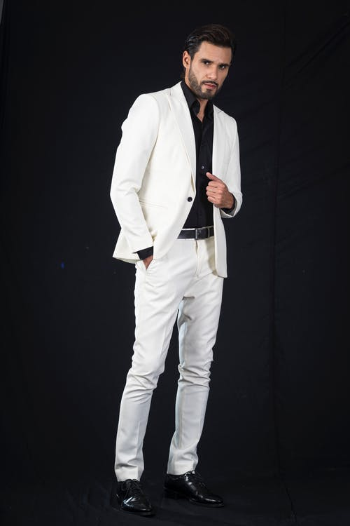 Man in White Suit Posing at the Camera