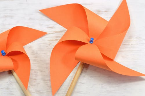 Two Orange Paper Windmills