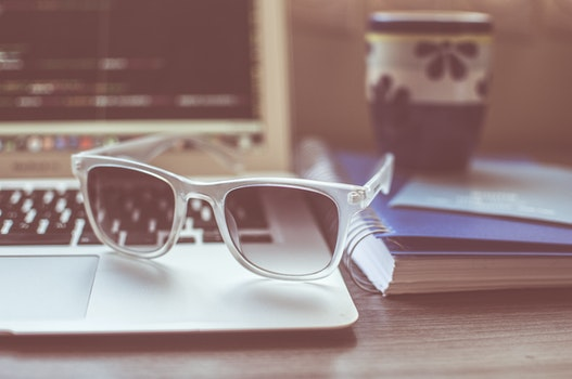 Free stock photo of sunglasses, cup, mug, desk