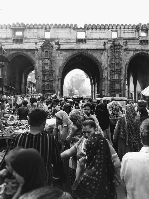 Grayscale Photo of People in a Street