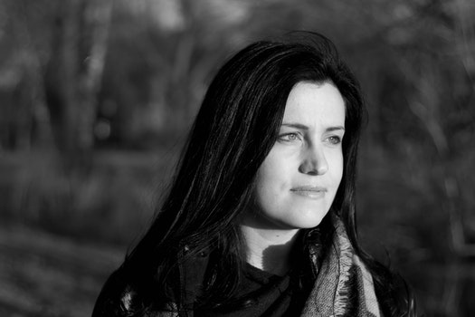 Grayscale Photo of Woman Wearing Scarf