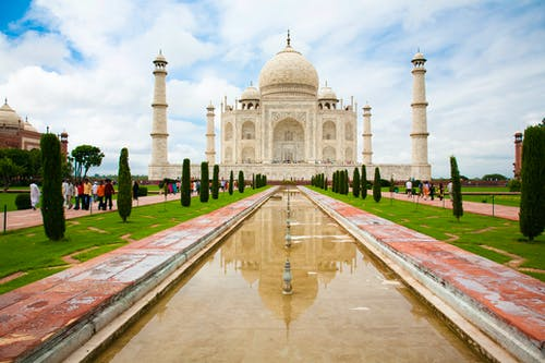Amazing Taj Mahal Mausoleum under Cloudy Sky