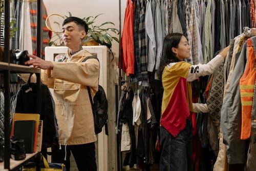 Woman in Brown Coat Standing Beside Woman in Black Jacket