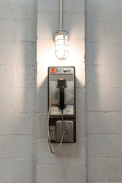 Black and White Wall Mounted Telephone