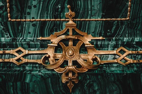 Gold Cross on Green Textile