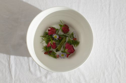 White bowl with fresh delicate flowers