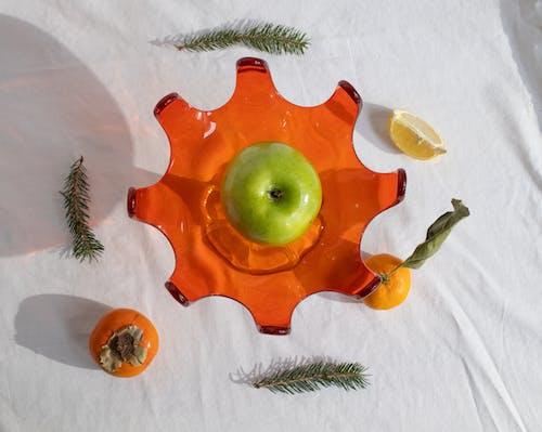 Fresh green apple placed on vase