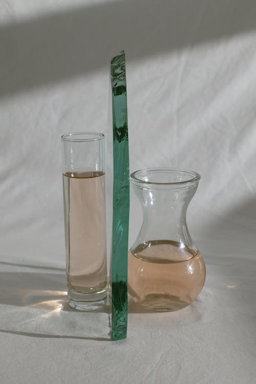 Glassware with light liquid on fabric